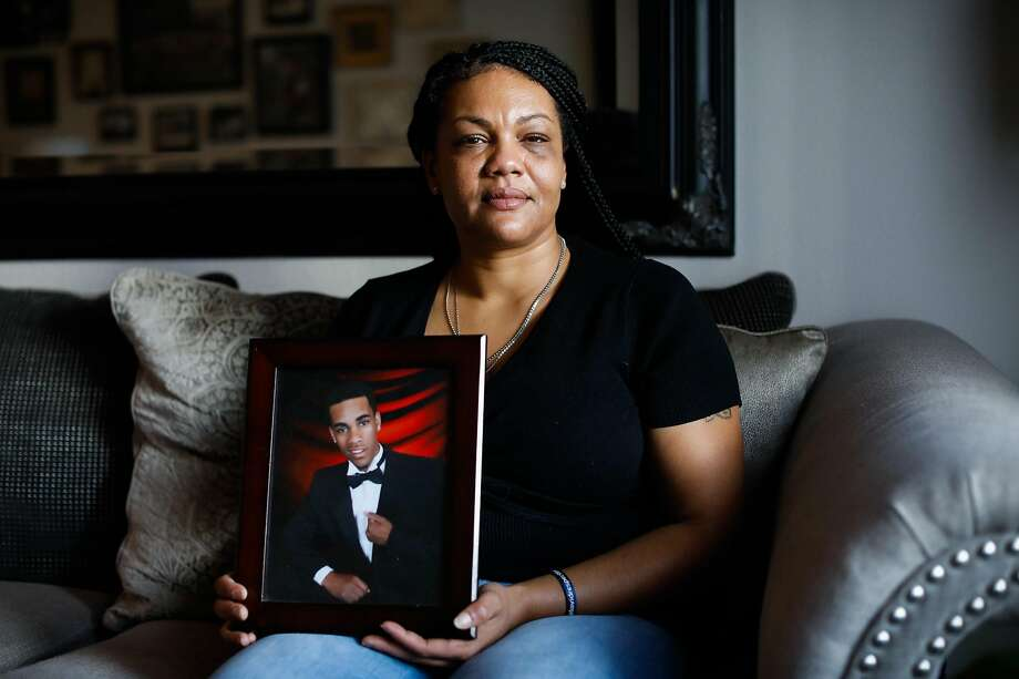 Jasmine Hardison of San Ramon holds a photo of son David McDaniel Jr., who was slain in 2016. Photo: Gabrielle Lurie / The Chronicle