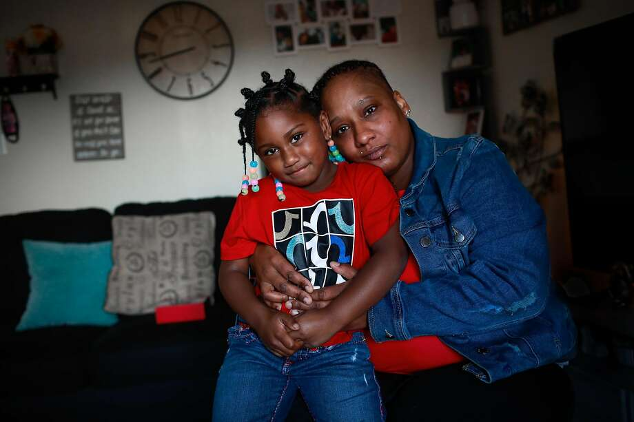 Khante Johnson and daughter Destinee Johnson, 4, at their home in Richmond. Khante's partner and Destinee's father, Keith Williams, was slain in 2017 while he was selling his car. Photo: Gabrielle Lurie / The Chronicle
