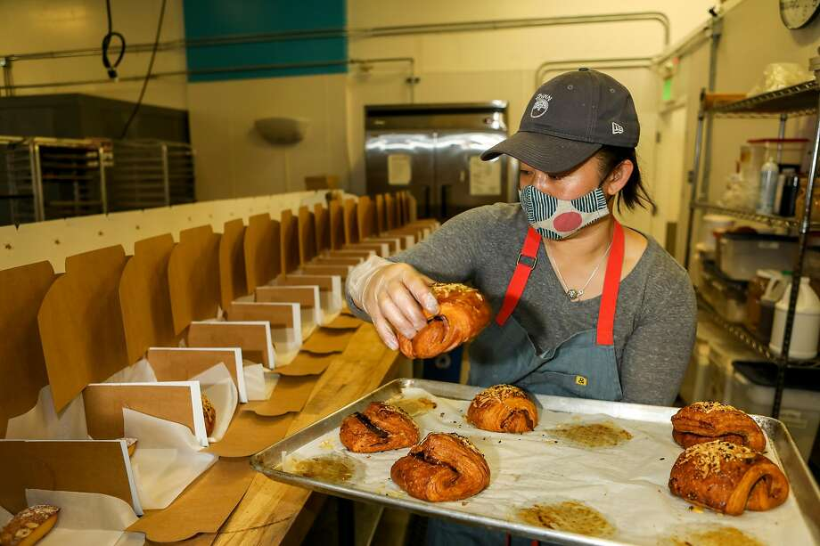 Joyce Tang, baker and founder of Bake Sum pastries, places pastries into boxes that will be sold to customers on Friday, December 11, 2020, in Berkeley, Calif. Photo: Yalonda M. James / The Chronicle