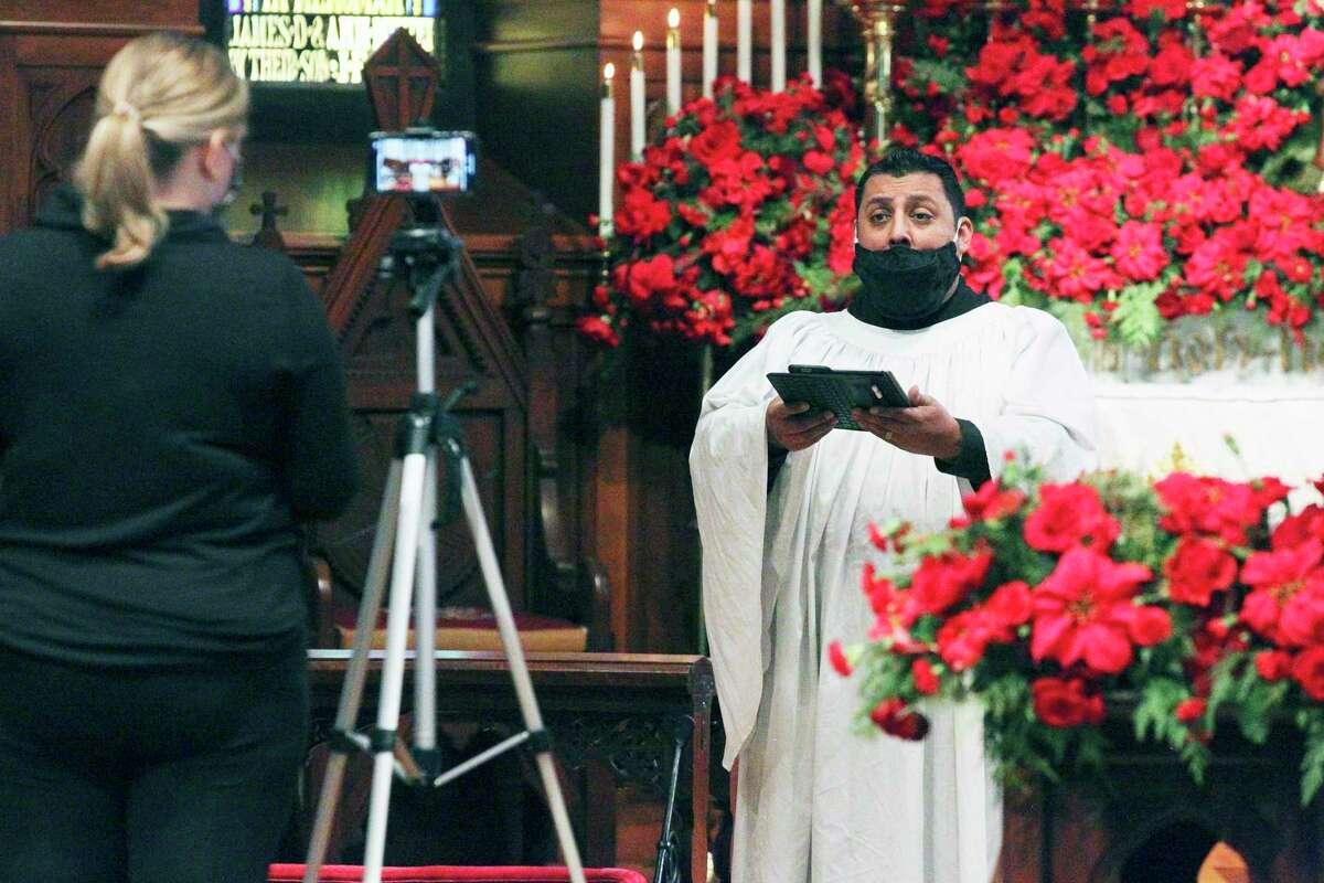 Singer Michael Zuniga tapes his performance as St. Mark's Episcopal Church recorded its Christmas Day service Tuesday for a virtual presentation.