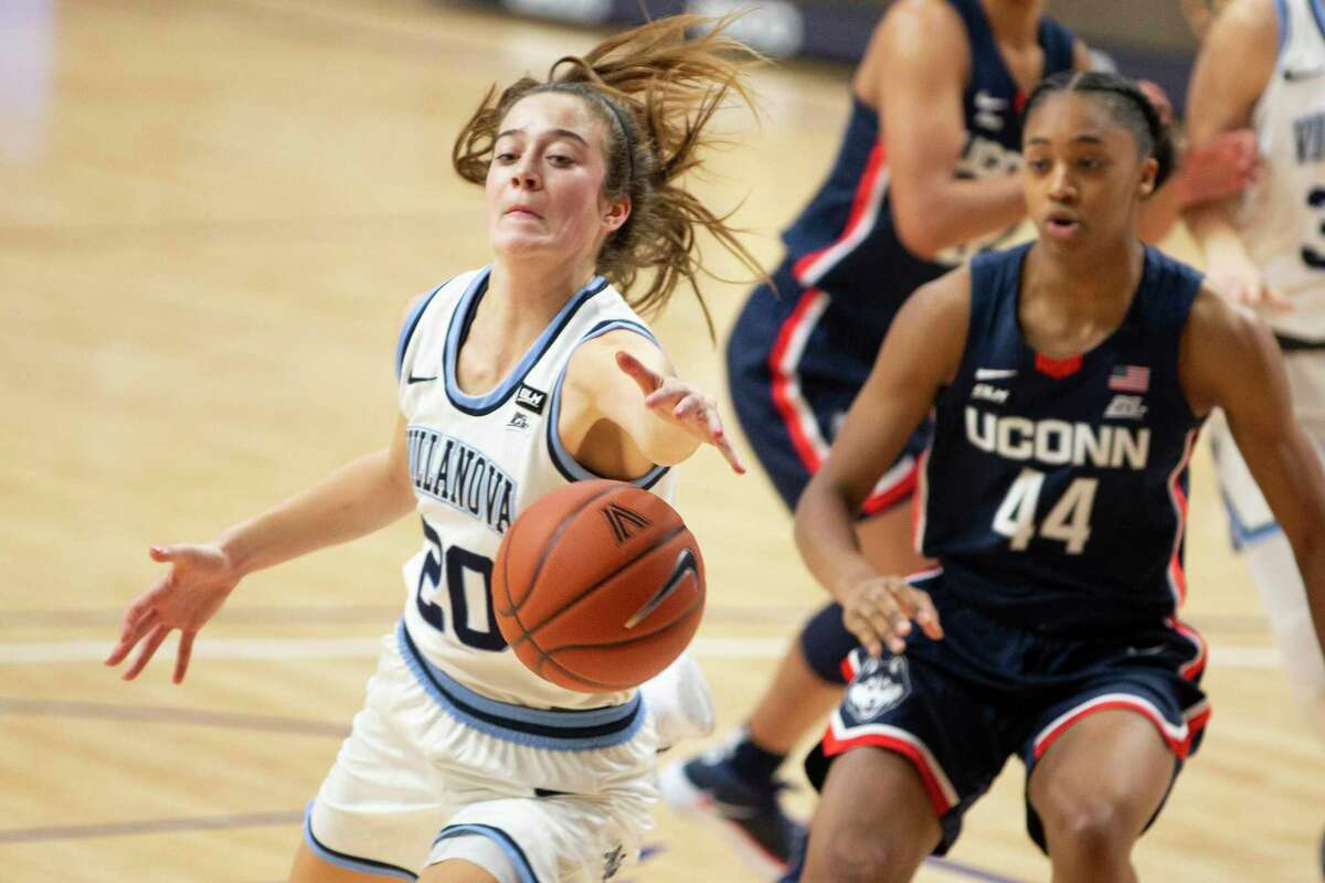 Villanova's Maddy Siegrist, left, reaches for a rebound next to UConn's Aubrey Griffin during the first half on Tuesday.
