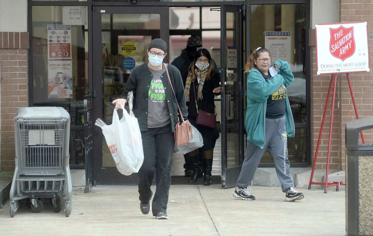Shoppers make their way out of Hobby Lobby in Beaumont Monday as area retailers and restaurants continue to encourage masks while in the premises, particularly as case numbers remain high. Photo taken Monday, December 14, 2020 Kim Brent/The Enterprise