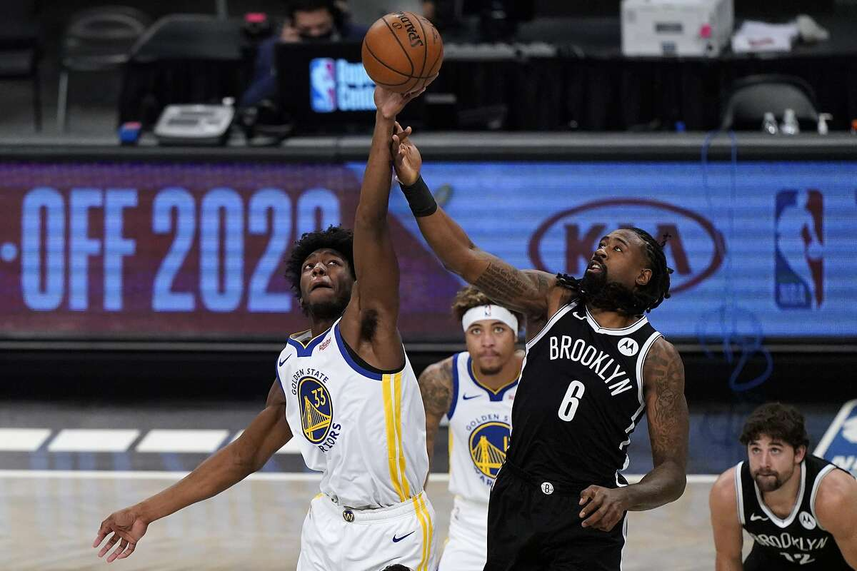 Golden State Warriors center James Wiseman (33) and Brooklyn Nets center DeAndre Jordan (6) tip-off at the start of the first quarter of an opening night NBA basketball game, Tuesday, Dec. 22, 2020, in New York. (AP Photo/Kathy Willens)