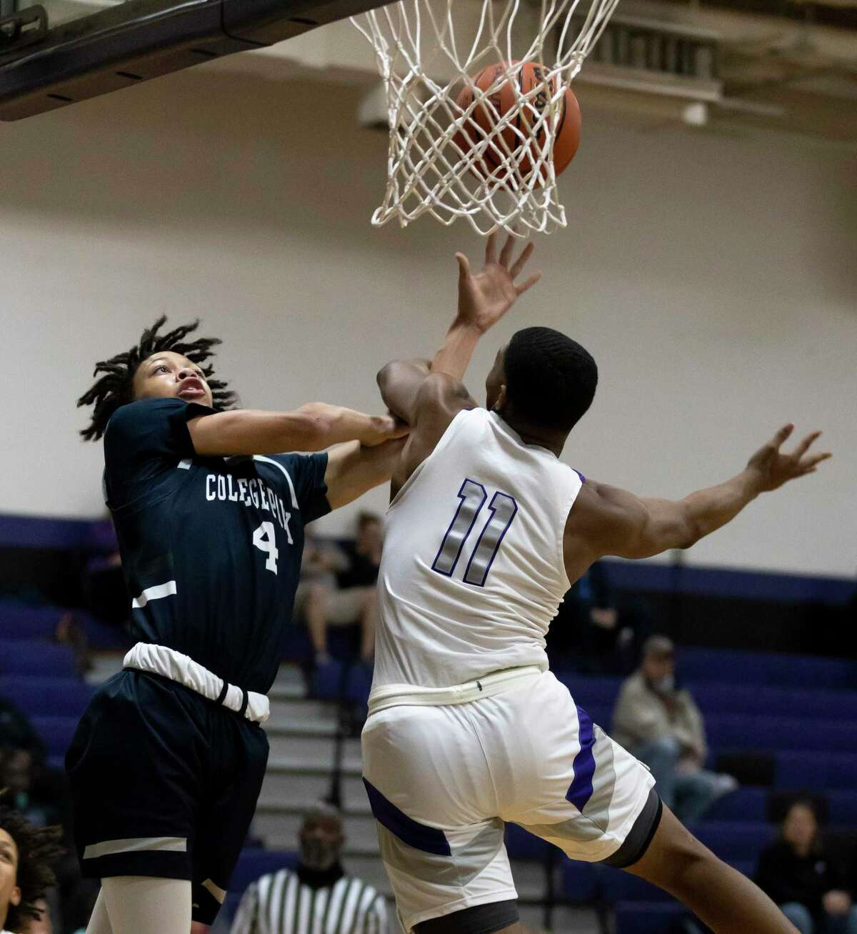 College Park guard Darel Reece (4) misses the basket due to pressure from Willis point guard Terrance Patterson (11) during the first quarter of a District 13-6A boys basketball game at Willis High School, Tuesday, Dec. 22, 2020, in Willis.