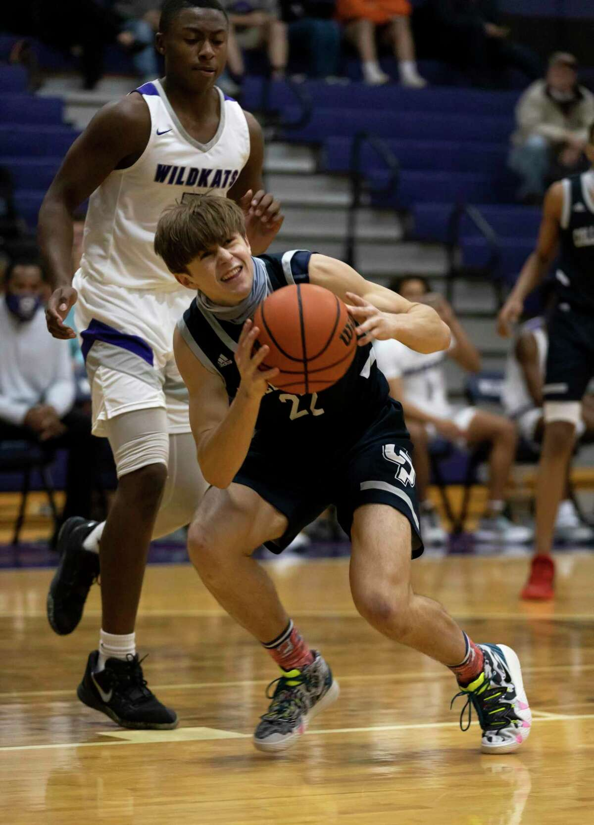 College Park guard Logan Maksimowicz (22) stops near the basket to shoot the ball while under pressure from Willis Ja'Kobe McCoy (15) during the first quarter of a District 13-6A boys basketball game at Willis High School, Tuesday, Dec. 22, 2020, in Willis.