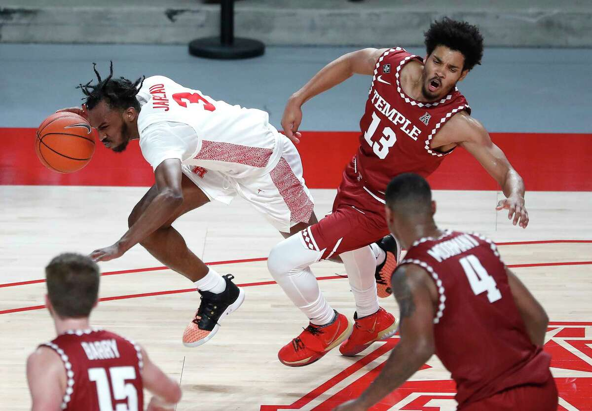 Houston Cougars guard DeJon Jarreau (3) is called for a foul on Temple Owls guard Tai Strickland (13) during the first half of an NCAA men's basketball game at Fertitta Center, Tuesday, December 22, 2020, in Houston.