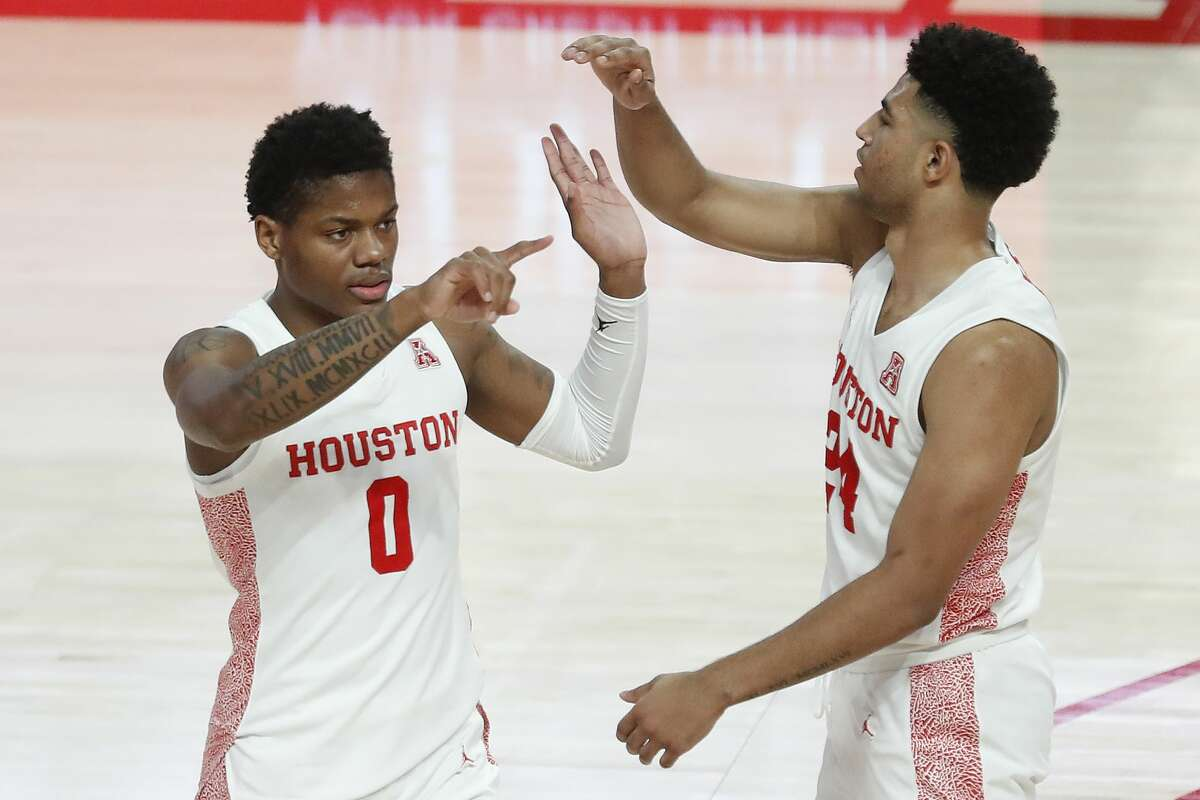 UH guard Marcus Sasser (0) celebrates a three-pointer with teammate Quentin Grimes during the first half Tuesday against Temple.