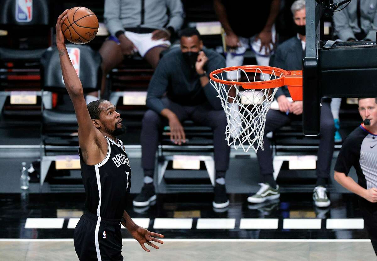 The Nets' Kevin Durant dunked for two of his 22 points in his first game since the 2019 Finals.