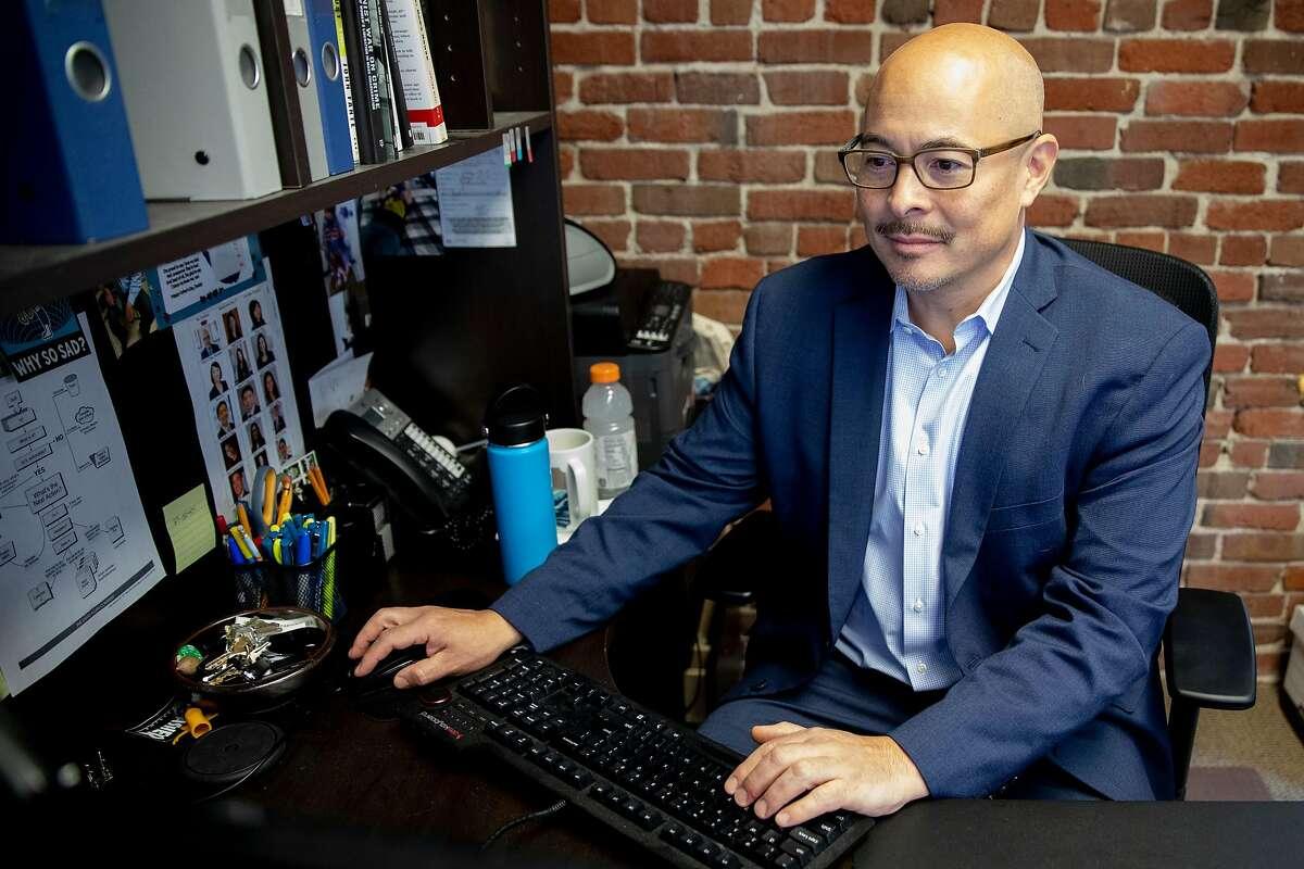 San Francisco Police Commissioner John Hamasaki works at his office in San Francisco, Calif. Tuesday, December 22, 2020.