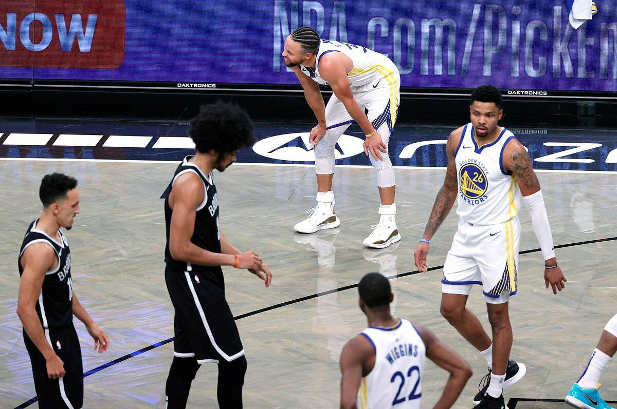 Stephen Curry (top) and the rest of the Warriors chased the Nets all night long, on the hardwood as well as on the scoreboard.