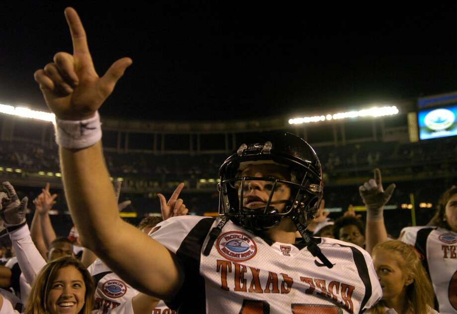 Texas Tech quarterback Sonny Cumbie celebrates 45-31 victory over Cal in the Pacific Life Holiday Bowl at Qualcomm Stadium in San Diego, Calif. on Thursday, Dec. 30, 2004. Cumbie was 39 of 60 for a career-high 520 yards and three touchdowns to lead the No. 23 Red Raiders to an upset of No. 4 Cal. (Photo by Kirby Lee/Getty Images) Photo: Kirby Lee/Getty Images