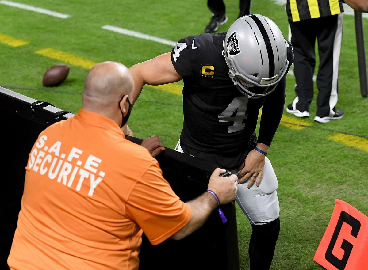 LAS VEGAS, NEVADA - DECEMBER 17: Quarterback Derek Carr #4 of the Las Vegas Raiders comes off the field after suffering a groin injury on a third-down run against the Los Angeles Chargers in the first half of their game at Allegiant Stadium on December 17, 2020 in Las Vegas, Nevada. The Chargers defeated the Raiders 30-27 in overtime. (Photo by Ethan Miller/Getty Images)