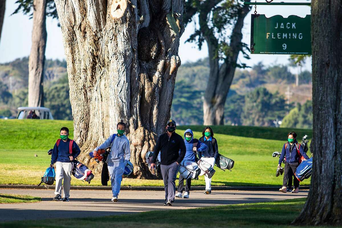 Members of San Francisco chapter of the First Tee walk to the driving range at Harding Park in San Francisco this month.