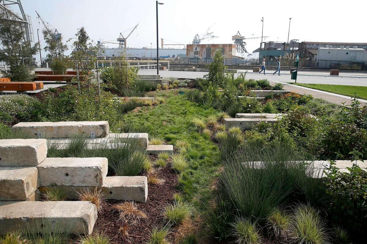 Visitors explore the new Crane Cove Park near Pier 70 in San Francisco.