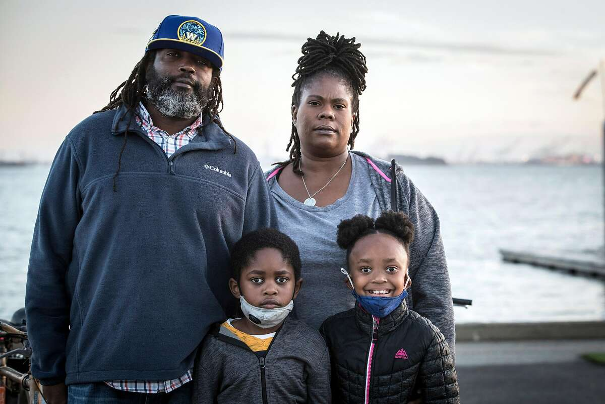 Lisa Reed, with her husband, Chris, daughter, Arissa, 8, and son Alonzo, 6, at the Berkeley Marina. Reed this week received word that she will be laid off January 4 from her job as a driver for Golden Gate Transit due to the COVID-19 pandemic and lack of riders on public transportation.