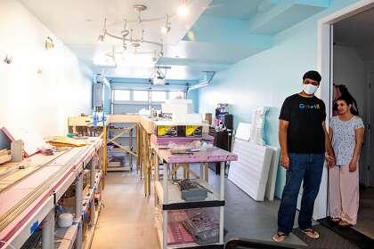 Google engineer Kiran Kaja and his wife, Sucheta Naranj, look at a model train set Kaja created.
