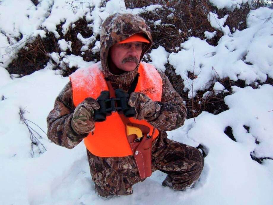 Tom Lounsbury appreciates the fact that a holstered handgun allows both handsto be free for glassing, as well as for going through rugged cover. (Photo provided/Tom Lounsbury/Hearst Michigan)