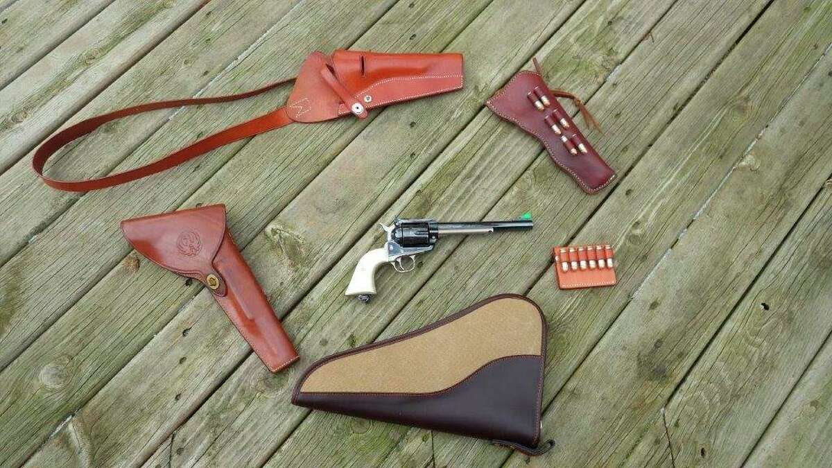 Tom Lounsbury truly appreciates quality leather holsters and accessoriesfor his customized Ruger Blackhawk revolver (center). Pictured around the revolver, clockwise from left, are a RugerBlackhawk