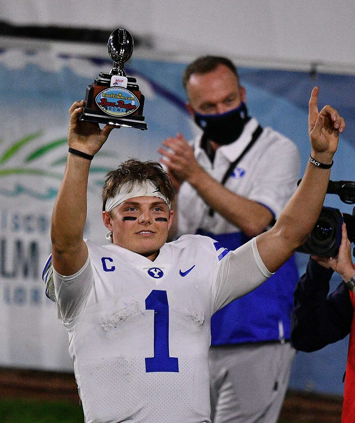 BOCA RATON, FLORIDA - DECEMBER 22: Zach Wilson #1 of the Brigham Young Cougars lifts the MVP Trophy after beating the Central Florida Knights 49-23 at FAU Stadium on December 22, 2020 in Boca Raton, Florida. (Photo by Mark Brown/Getty Images)