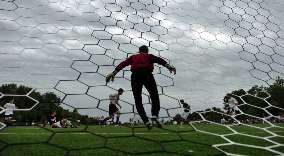 The brunt of Hurricane Earl decided not to pummel Connecticut like predicted on Friday, September 3, 2010. Here, as storm clouds cover the sky, Weathersfield goalie Billy Schmid stands ready to block a Staples goal attempt, during a soccer scrimage game at Wakeman Field in Westport, Conn.. Photo: Christian Abraham / Connecticut Post
