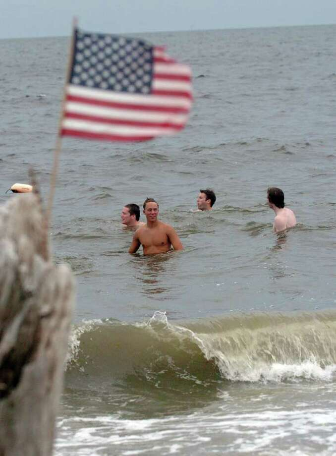 The brunt of Hurricane Earl decided not to pummel Connecticut like predicted on Friday, September 3, 2010. Penfield Beach in Fairfield, Conn., brought out many people to enjoy the water and beach even though winds and waves were high. Photo: Christian Abraham / Connecticut Post