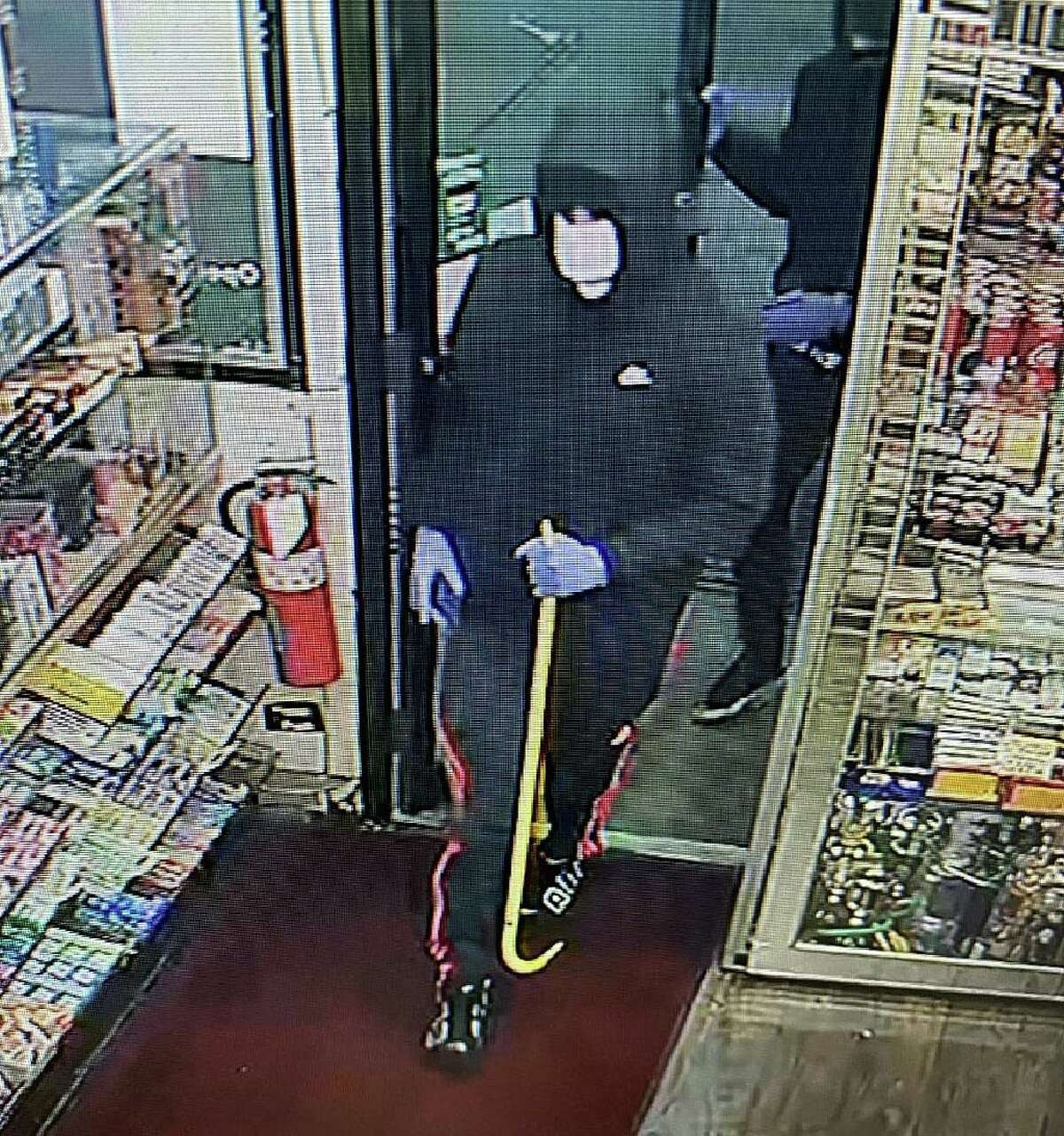 Police said multiple suspects robbed a gas station in Meriden, Conn., on Tuesday, Dec. 22, 2020.