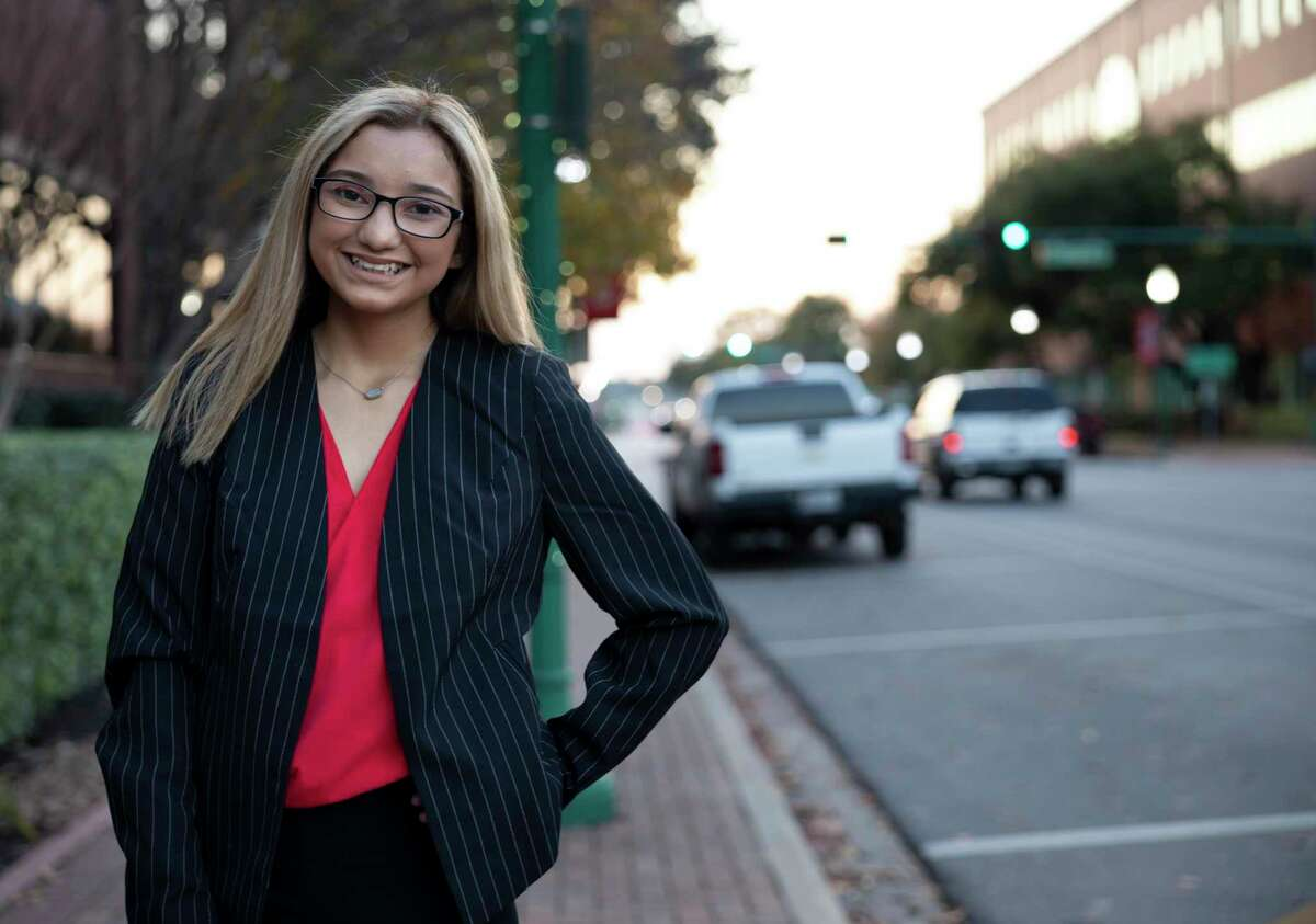 Vivian Sanchez poses for a portrait in front of the Alan B. Sadler Commissioners Court Building, Tuesday, Dec. 22, 2020, in Conroe. Sanchez is a teen sexual violence survivor who's become a state-wide advocate to raise awareness on the issue.