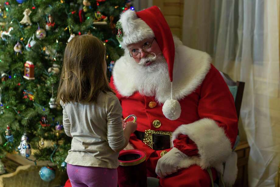 Michael Howe has worked as a professional Santa for more than 27 years. A former educator with Reed City Area Public Schools, Howe said being Santa gives him the chance to continue working with kids. (Courtesy photo) / Breedlove Photo Tech