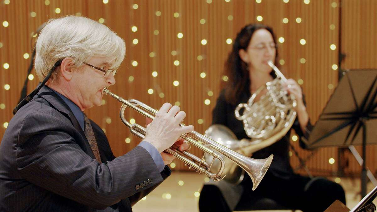 Don Batchelder, left, who plays trumpet in the Stamford Symphony Brass Quintet, is seen here with quintet member Eva Conti, on the French horn. The quintet invites you to celebrate the new year with a free concert/interactive event online on the symphony's website, Sunday, Jan. 3, at 3 p.m. Quintet members not seen here are Brian Brown (tuba), Richard Clark (trombone) and Timothy Schadt (trumpet).