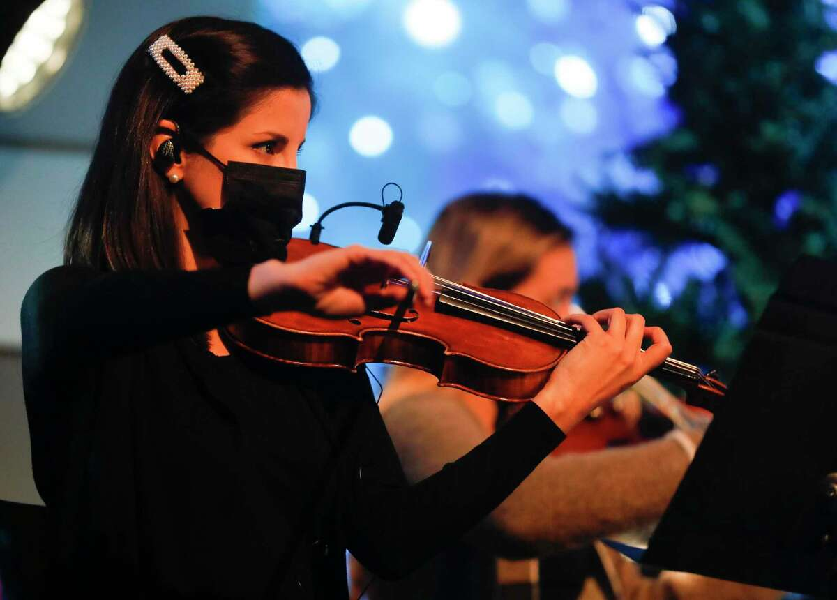 Musicians perform as 50 volunteers and staff members prepare four Christmas Eve services for both in-person and online worshipers at The Ark Church, Wednesday, Dec. 22, 2020, in Conroe.
