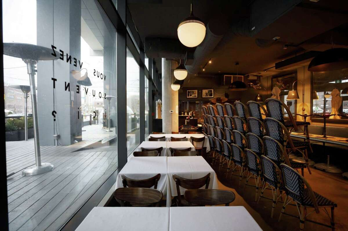 Empty chairs inside a restaurant in Toronto on Nov. 23, 2020.