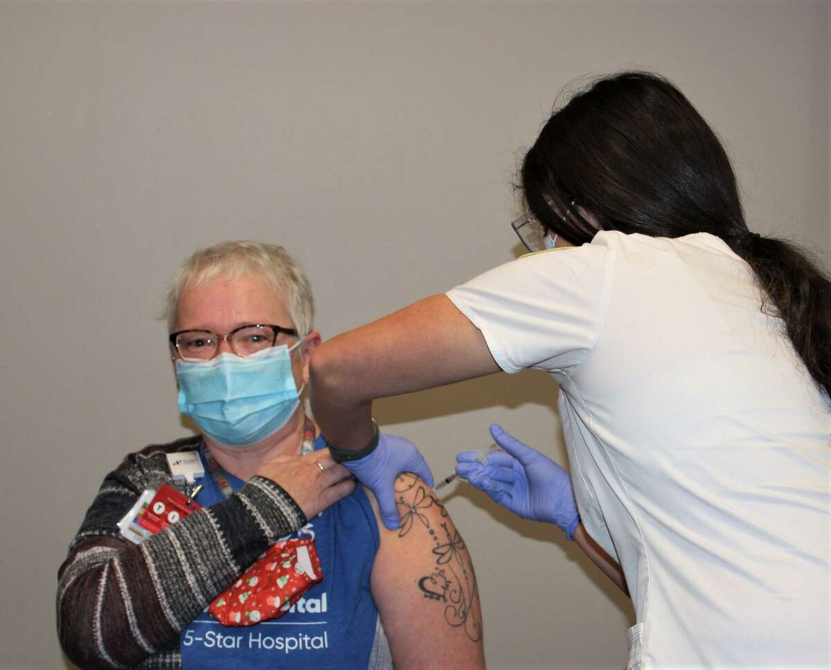 A Sharon Hospital staff member receives the COVID-19 vaccine.