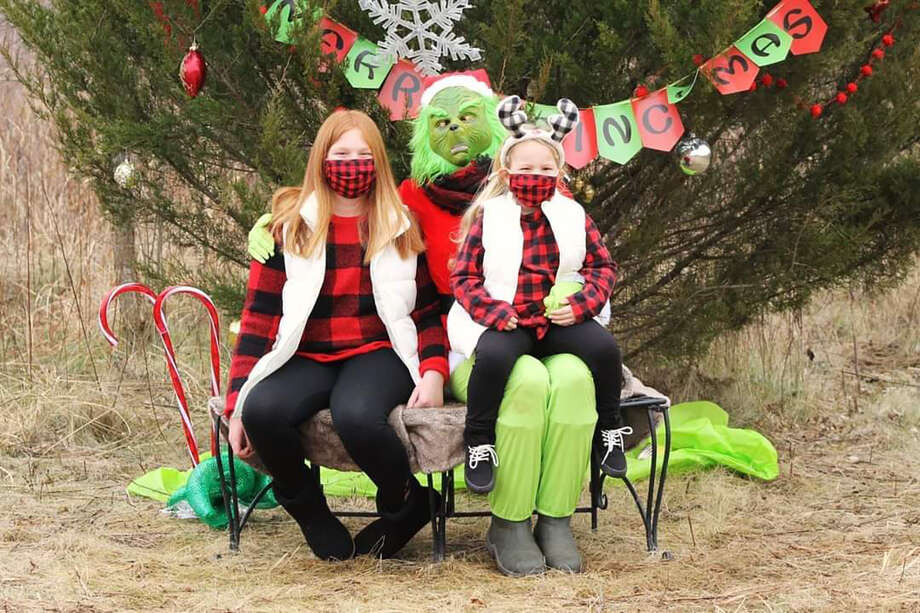 Families from all over gather to see the Grinch and take photos in rural Beardstown. Photo: Photo Provided