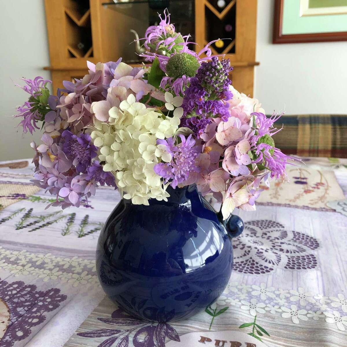 In Winchester, Va., Elizabeth Gomez used flowers for tabletop bouquets, including hydrangea, scabiosa, bee balm and buddleia.