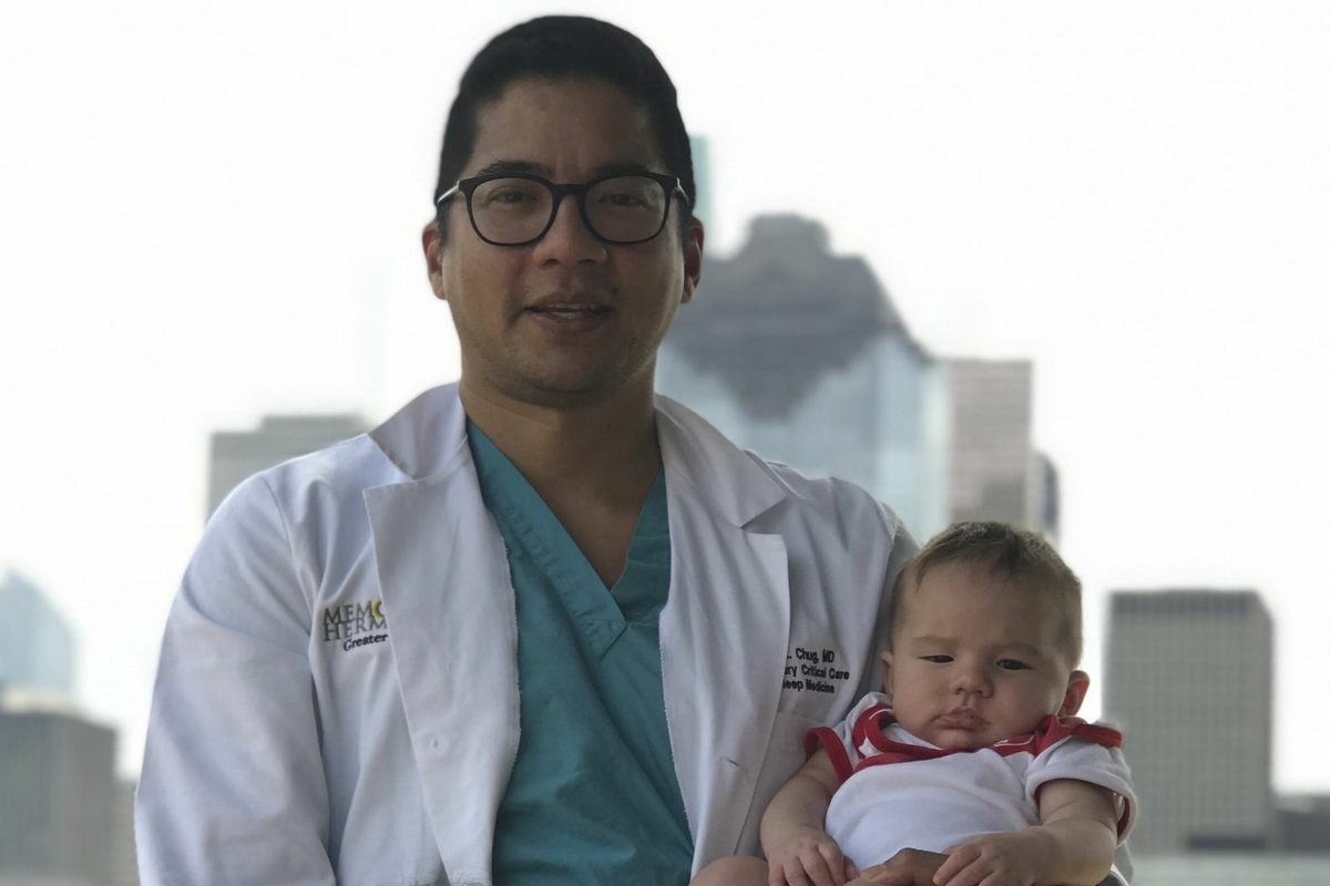 Dr. Luis Chug, here with his 9-month-old son, will receive his first dose of the COVID-19 vaccine this week.