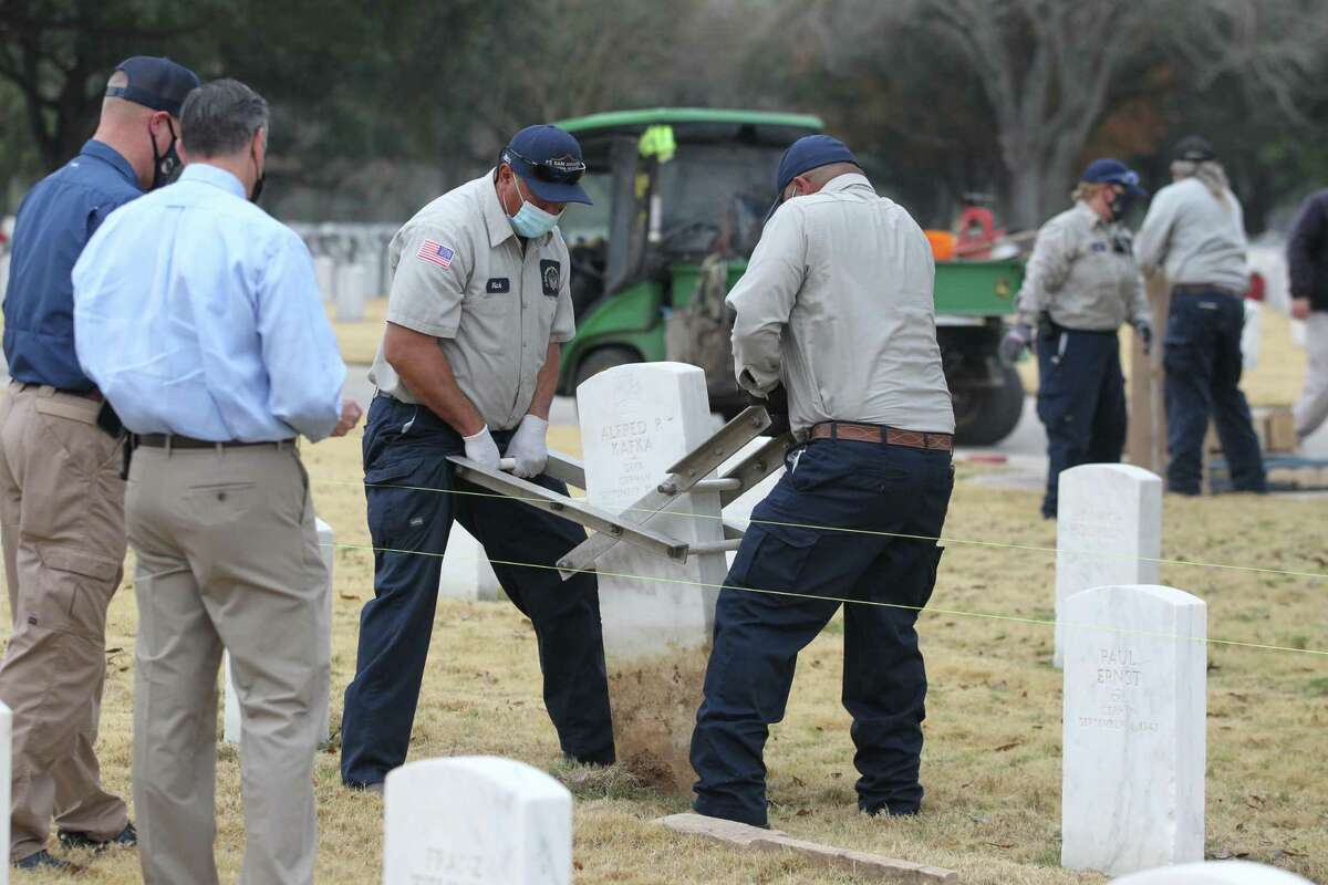 Ft. Sam Houston National Cemetery workers remove two German WWII graves with Nazi inscriptions and replace them with new headstones on Dec. 23, 2020.