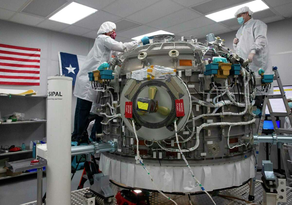 Nanoracks Director of Operations Steve Stenzel, left, and Lead Mechanical Engineer Mark Rowley work on installing protective panels to cover electronics and other parts of a Bishop Airlock Friday, Sept. 18, 2020, in Webster. The airlock will be shipped to Florida, where it will be launched to the International Space Station, next week. It will ultimately increase the number and size of satellites, equipment and experiments that can access space from the station.