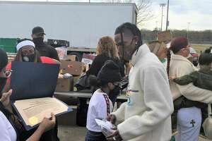 Travis Scott, Kylie Jenner and daughter Stormi were in Houston for the Cactus Jack foundation toy drive.
