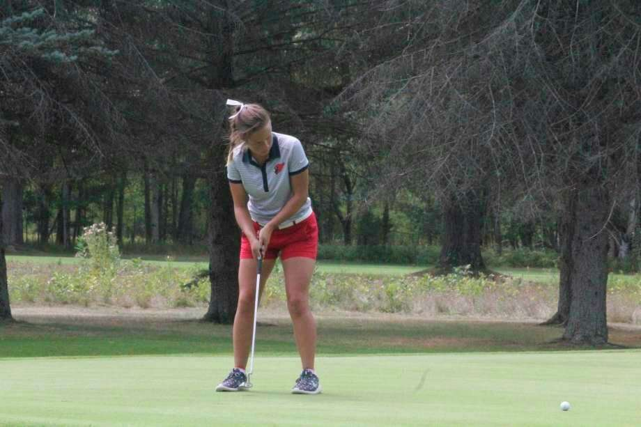 Lauren Posey, of Big Rapids, putts on the green during a match earlier this season. (Pioneer file photo)