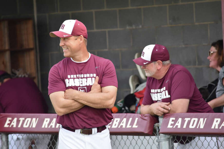 Rick Acker (left) coaches the Eaton Rapids High School varsity baseball team in this undated photo. Photo: Photo Provided