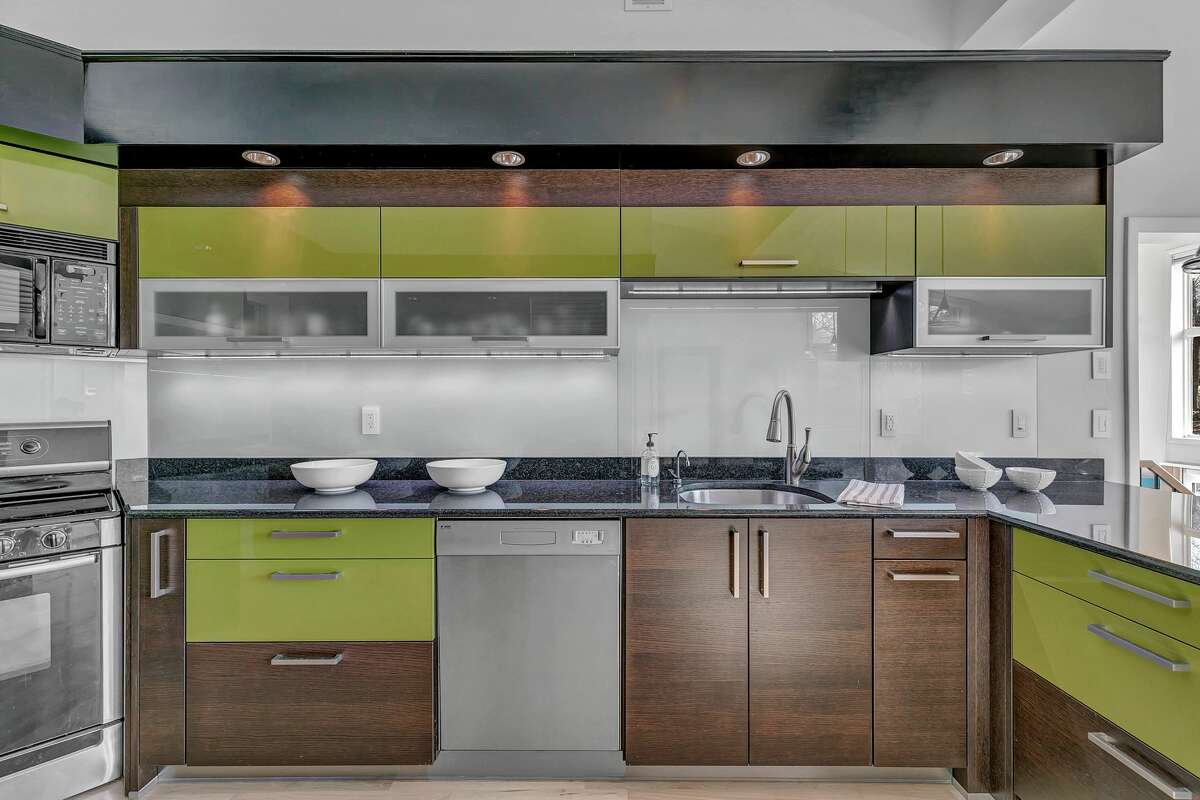 State-of-the-art European designer kitchen at 52 Knapp Street, Easton. The extensive renovation and re-design of this 10-room, 4,502 square-foot house, first built in 1985, include a long list of amenities that blend form and function. Among them are a $60,000 Lutron lighting system, generator, metal roof, a home office with custom cabinetry, luxurious marble master bath with radiant heated floor, au pair or guest suite, disability access features, and a gym/yoga studio with a dry bar and sliding door to the tennis/basketball court, two bluestone patios and a spacious deck. The professionally-landscaped grounds with majestic oak and maple trees are augmented by proximity to a nature preserve with hiking trails managed by the Aspetuck Land Trust.