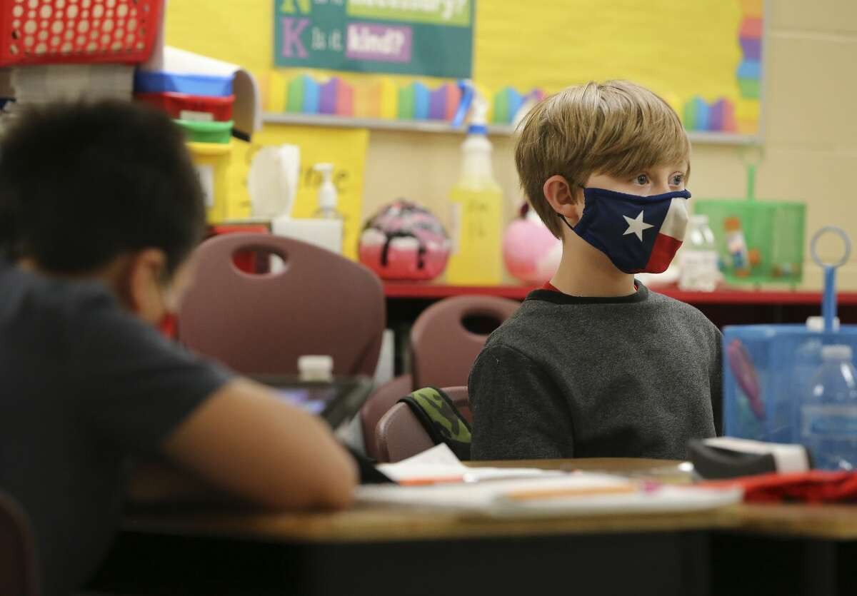 A third-grader at Pearce Elementary at Southside ISD attends class in December. NEISD trustees recently voted to make masks optional for students during outdoor recess and physical education