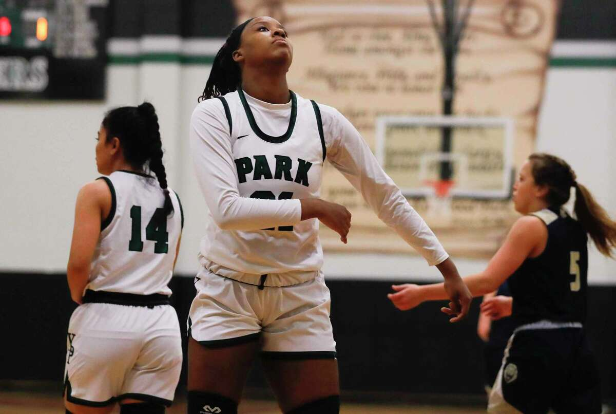 Kingwood Park forward Biva Byrd (21) reacts after fouling Lake Creek point guard Kennedy Oliver during the first quarter of a District 20-5A high school basketball game at Kingwood Park High School, Tuesday, Dec. 22, 2020, in Kingwood.