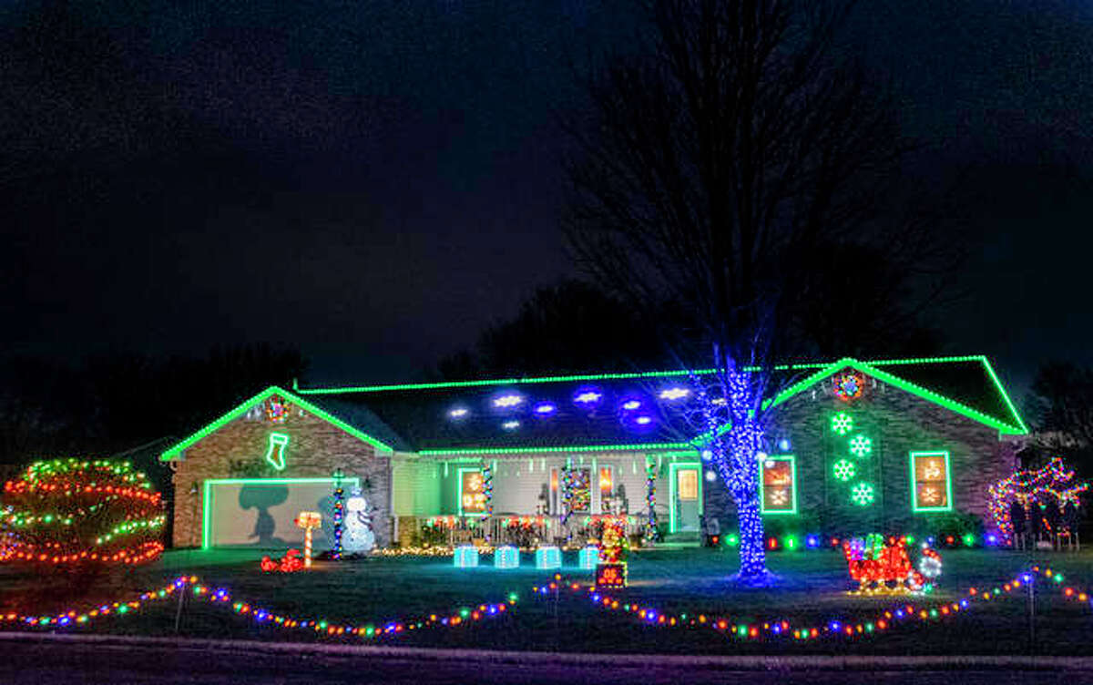 A home lit up with thousands of Christmas lights is one of three homes that make up a light show on Barbarotto Lane in Maryville, which is coordinated by one family.