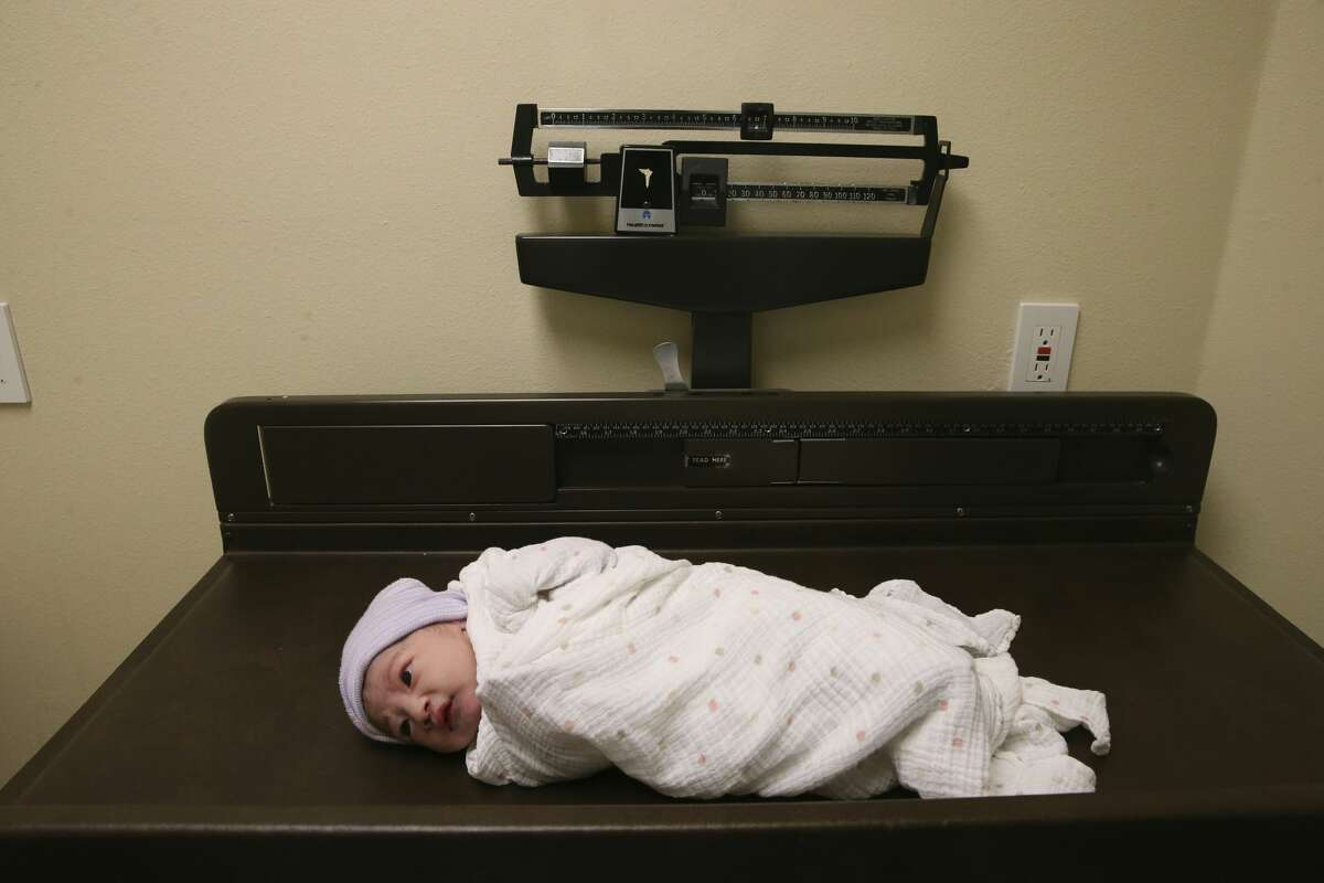 Newborn Miranda Linette Zamarripa weighs in at 6.12 lbs. after her birth at Maternidad Laredo in Laredo, Texas, Monday, Sept. 21, 2020. Her mother, Arleth Garcia, 24, was under the care of license midwife Ruben Casillas, who started the clinic in 2003.