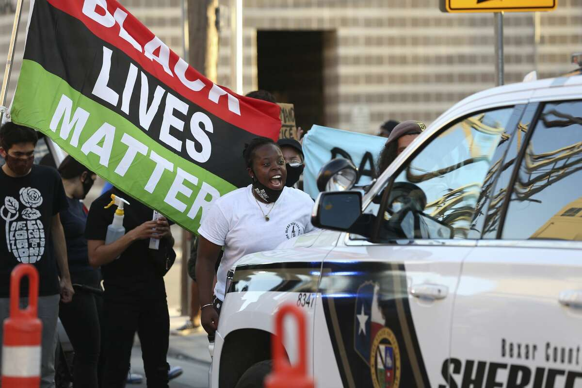 Protesters surround a Bexar County Sheriff's unit outside the county jail, Wednesday, Aug. 26, 2020. The group was protesting the Tuesday shooting death of Damien Lamar Daniels by deputies.