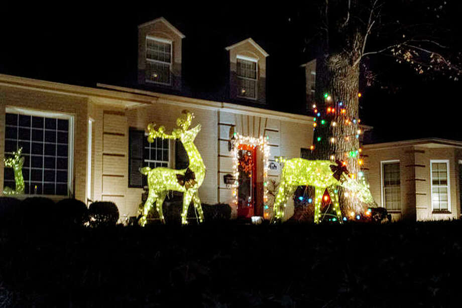 A home stands decorated for the holidays on St. Louis Street in Edwardsville, one of the many neighborhoods that include multiple homes that are lit up this year. Photo: Tyler Pletsch | The Intelligencer