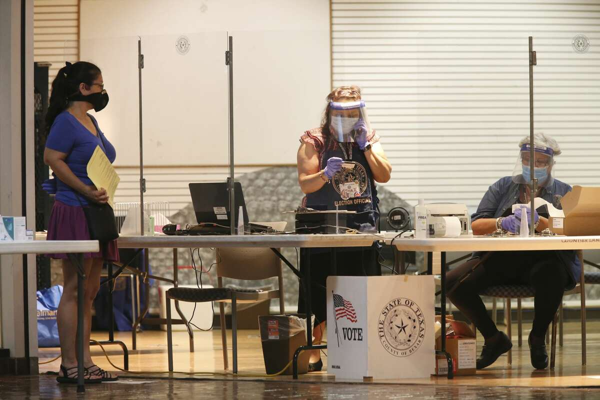 Poll workers wear protective at the Wonderland of the Americas Mall polling site, Monday, June 29, 2020. Precautions are taken due to coronavirus concerns. Early voting started for the July 14th primary runoff election.