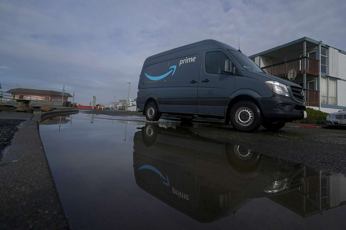 An Amazon delivery vehicle travels through Pacifica in December.