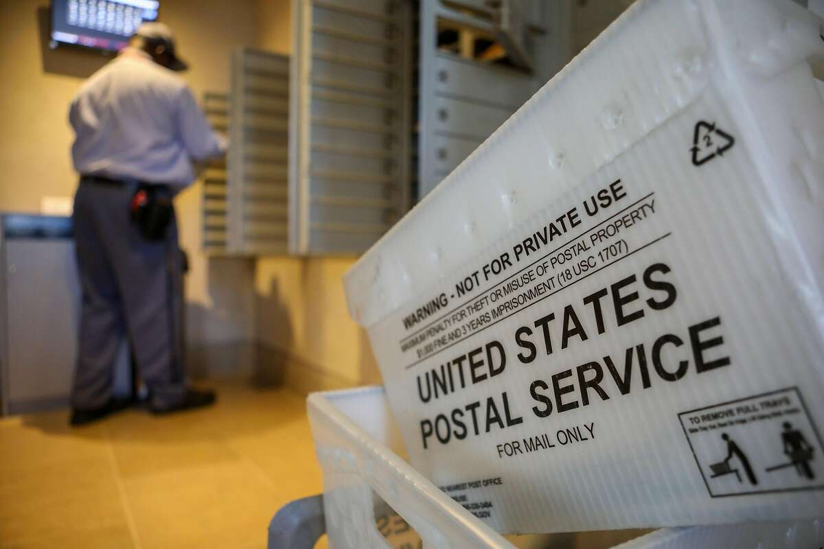 Keith Massey, 60, a 38-year U.S. Postal Service employee, works his mail route in Oakland in November.